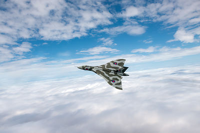 Vulcan turning above clouds