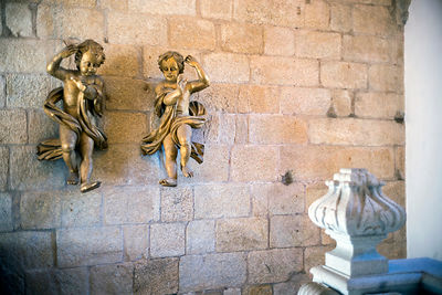 Details of golden cherubs in the Cloisters of the Porto Cathedral (The Porto Cathedral (Sé do Porto), Porto, Portugal.