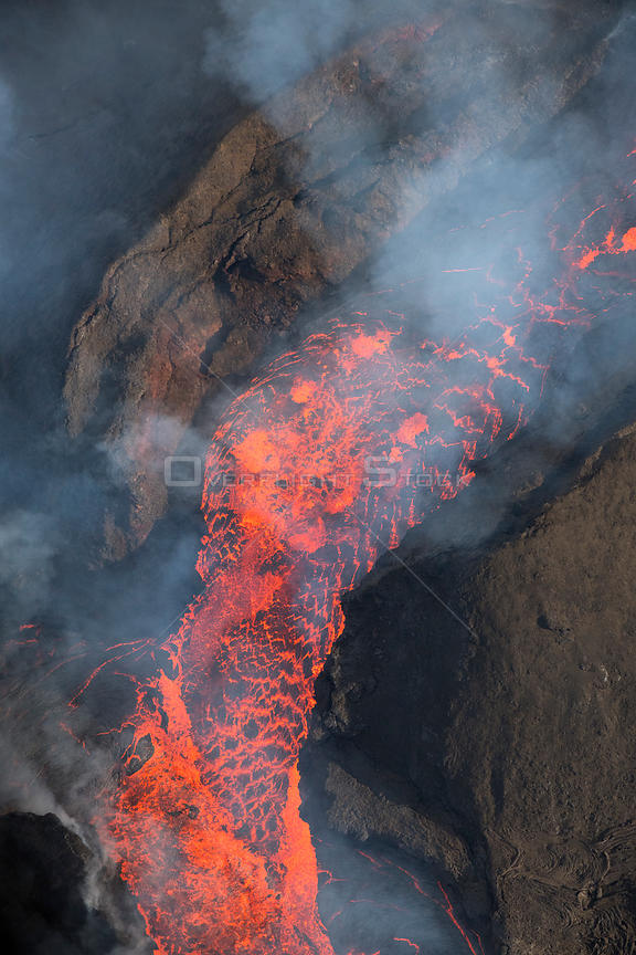 Lava erupting from fissure 8 of the Kilauea Volcano, boiling out of cinder cone.  East rift zone in Leilani Estates, near Pah...
