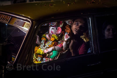 A man arrives at Chowpatty Beach by taxi with his Ganesh idol to immerse it in the Arabian Sea, during the Ganesh Chaturthi f...