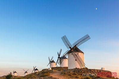 Spain, Castile–La Mancha, Consuegra. Windmills at sunset