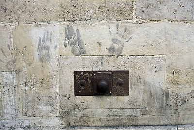 France - Paris - Architectural details and handprints on a wall on the Rue Mouffetard.