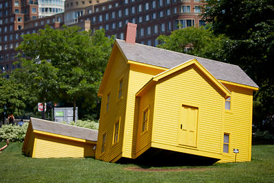 Upside-down yellow house