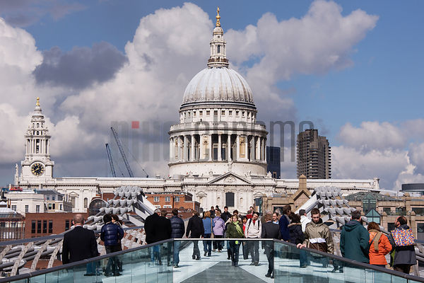 Pedestrians Crossing the Millennium Bridge with St Paul's Cathedral in the Background