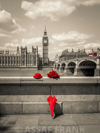 Bunch of Roses, hat and umbrella on Thames promenade, London, UK