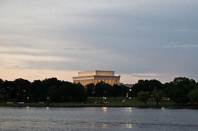 The Lincoln Memorial floodlit at dusk, as seen from a Potomac River cruise in Washington DC.