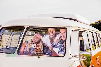 Happy friends inside van