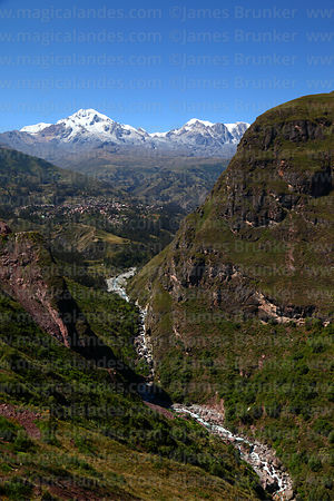 San Cristobal river, Sorata and Mts Illampu (L) and Ancohuma (R) behind, Bolivia