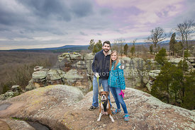 Boxer dog with his humans at garden of the gods in Illinois