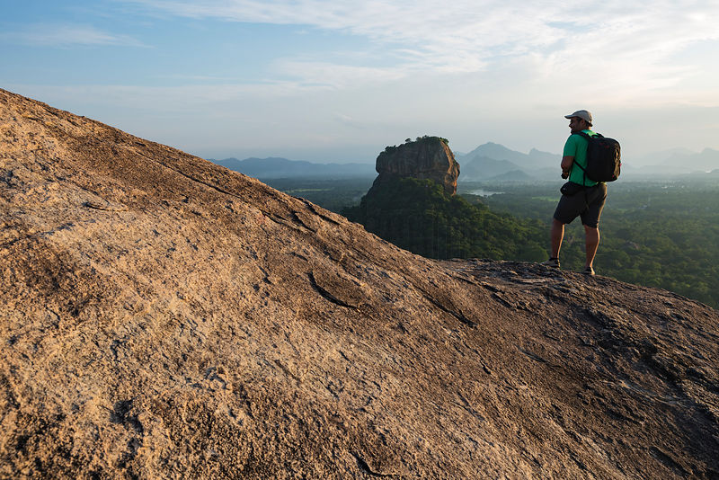 Abhi Stands on the Edge of Pidurangala Rock, Admiring Sigiriya