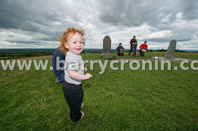 23rd August, 2014.Pictured at the Lia Fáil on the Hill of Tara is from left: Tribal Spirit Drumming's Coby Baker, music facil...