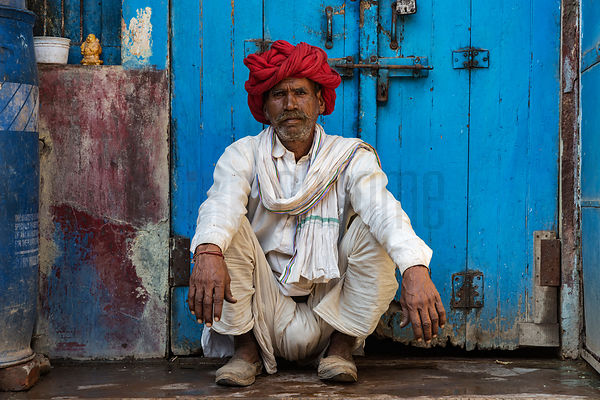 Portrait of a Red-Turbaned Man against a Blue Door in the Streets of Bundi