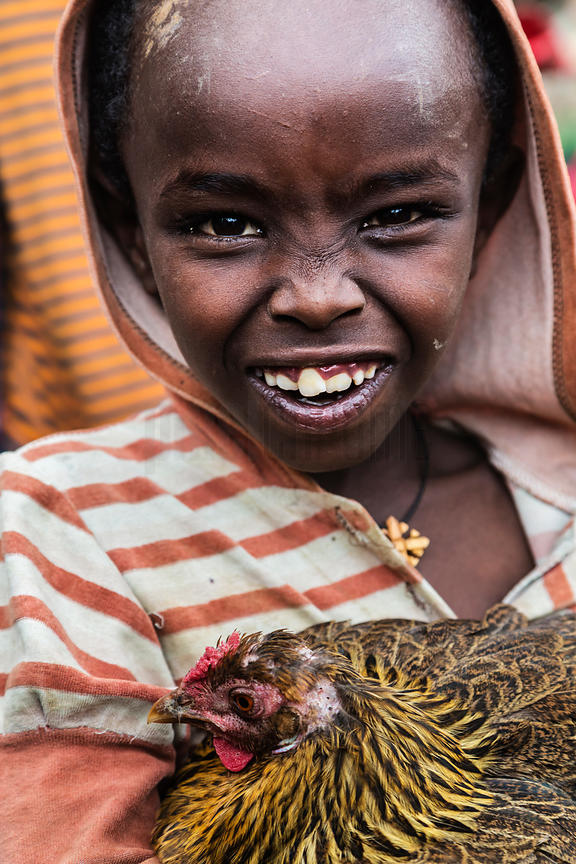 Young Boy Holding a Chicken at the Mercato Open Air Market