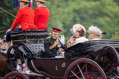 Prince Harry Waving to the Crowds from a Carriage with Princess Catherine and Camilla