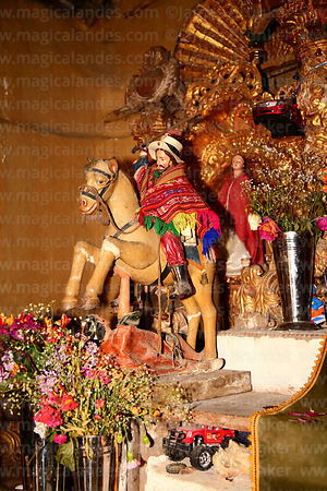 Statue of San Santiago / St James the Moor Slayer wearing local style poncho in church at Markacocha, Patacancha Valley, Cusc...