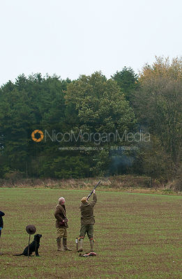 a gun at their peg during a game shoot