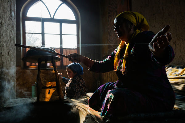 Women Spinning Silk Threads from Cocoons in the Ancient Way of the Fergana Valley