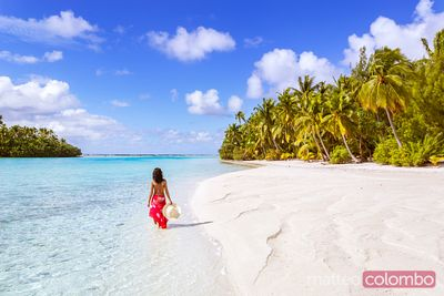Woman in bikini on the beach, One Foot Island, Aitutaki