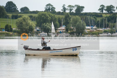 Fisherman fly fishing from a boat on Rutland Water