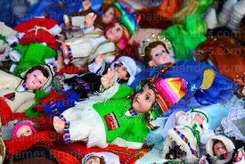 Baby Jesus figures for nativity scenes wearing traditional Andean clothing for sale in Christmas market, La Paz, Bolivia