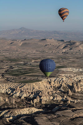 Hot air balloons near Uchisar city, Cappadocia, Turkey, March 2006.