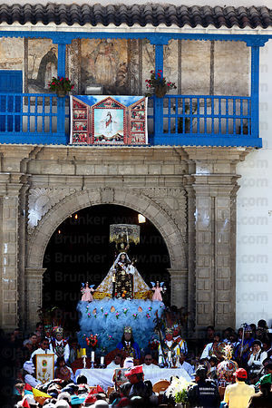 Central mass for Virgen del Carmen outside church before main procession , Paucartambo , Peru
