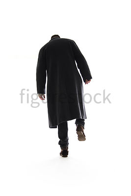 A Figurestock image of a mystery man, in a long black winter coat, walking away, possibly in snow or up a staircase – shot fr...