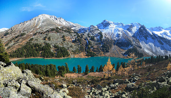 Lake Upper Multinskoe, a typical tarn lake in the sub-alpine belt of Altai Mountains with groves of Siberian pine trees  Russ...