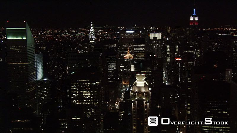 Night flight eastward across midtown Manhattan.