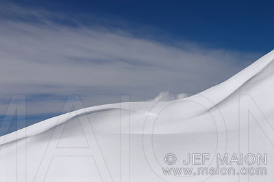 Smooth curves in a snow slope