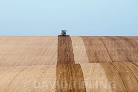 Tractor ploughing rolling farmland near Docking North Norfolk March