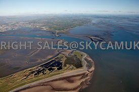 South Walney Nature Reserve and Walney Island Lighthouse looking towards Ulverstone and the Lake District Lancashire