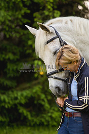 white horse and owner laughing