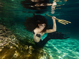 Hunter Mermaid Kristi Sherk in shallow water near Sand Dollar Beach, Highbourne Cay, Exuma Cays, Bahamas Islands during Merma...
