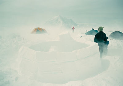 Ed Maginn inspects his igloo at the 14,000' on Denali's West Butress