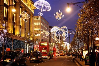 Traffic Passing Christmas Decorations in Oxford Street London at Night
