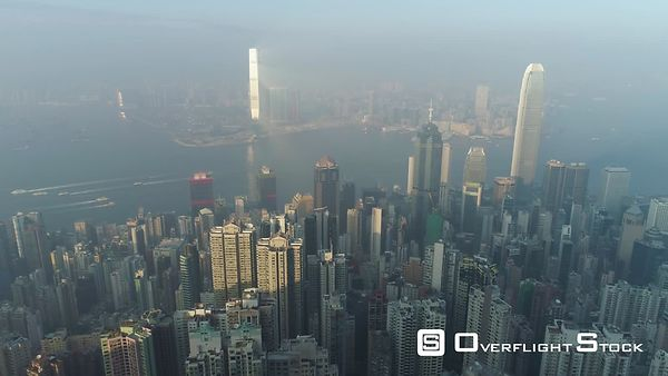 Hong Kong Skyline and Victoria Harbour. Aerial View. Drone is Flying Sideways Fast. Establishing Shot.