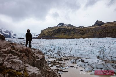 Young man looking at Svinafellsjokull glacier in south Iceland