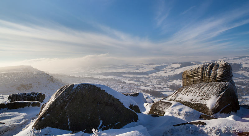 Snowy boulders on Curbar Edge Peak District