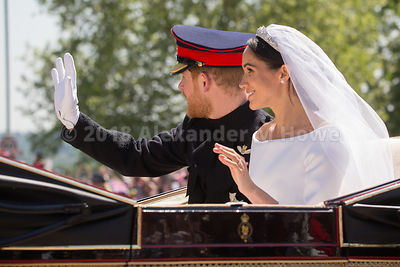 The newlywed royal couple - Harry and Meghan - wave to the crowd in The Long Walk during the carriage ride after their wedding