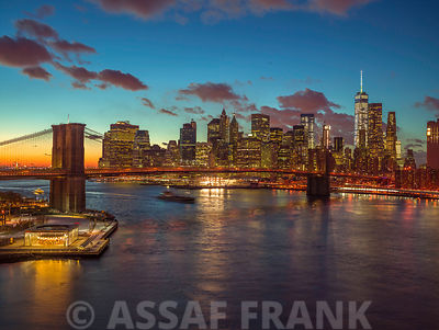 Evening view of Lower Manhattan skyline with Brooklyn bridge over East river, New York