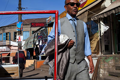 Ethiopia - Addis Ababa - A stylishly dressed man walking through the Piazza district