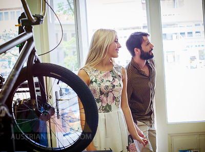 Young couple in a bicycle shop