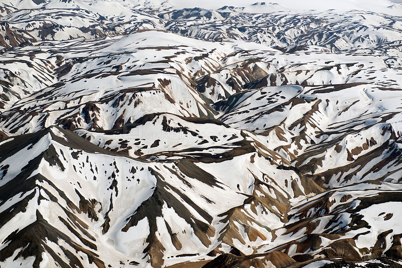 Aerial view of snowy mountain landscape, Landmannalaugar, Iceland, June 2014.