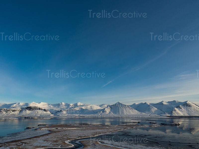 Beautiful blue skies over snow-covered mountains in Borganes, Iceland