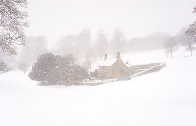 Chatsworth cottage in snow