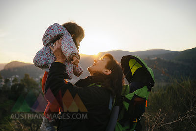 Spain, Barcelona, grandmother with granddaughter during a hike at sunset