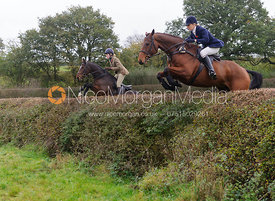 Harriet and Zoe Gibson jumping a big hedge - Quorn at Barrowcliffe 1-11-13