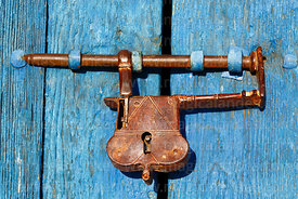 Old fashioned brass padlock on door of church, Cariquima, Region I, Chile