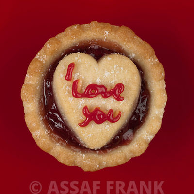 Single jam tart on red background